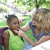 """Four-year-old Zariaha has her face painted by Kathy Somerville at the Rape Crisis Services booth in Downing Park during the """"Speak Out"""" - stopping sexual violence in our community on Saturday, August 23, 2008."""