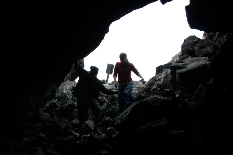 Jess and Tracy stepping gingerly into a lava tube.