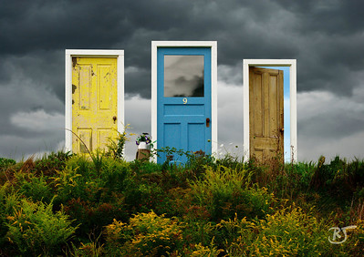 Day 196 - The Field of Three Doors      Wasn't that a Moody Blues tune... Timothy Leary...  Thanks to a creative artist in Grand Pre who placed three doors in their field.  When I saw them I was totally taken back, and said WOW!   I can imagine with a blue sky what it must look like.  The image is a composite of two images I took today.  The clouds are from a nasty wicked storm that moved in earlier today.  Wicked lightning and wind.  Pouring cats and dogs.  The color of the clouds is the original color, no desaturation.   The second image, the three doors, I removed the pale white sky and overlayed onto the clouds.  I added a blue tint to the door on the right, and inverted the sky on the middle door.  The middle door has me thinking... whats with #9... maybe a Beatles reference.  Just moments earlier we saw three bald eagles in the corn fields looking for pheasants. I was trying to get closer and setup my tripod, but before I could even setup the tripod he was in the air.  I think he was waiting for the other younger eagle to finish his fly by.. sort of like a parent watching if the kid did okay. :)  Very few shorebirds today, I think they flew out of harms way prior to the nasty storm.  Aug 31 2008