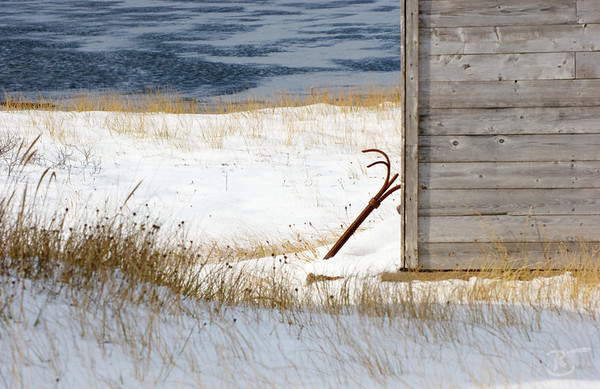 Day 256 - The Old Fishing Shed  An abandoned fishing shed sits idle as the snow piles up and another cycle of the tide reveals frozen mud reflecting the blue sky. Don't be fooled by the calmness of the scene, the windchill was in the negative numbers and made you quite aware winter has arrived.  Fishermans Reserve, NS   Nov 25 2008
