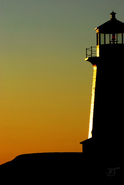 Day 263 - Lighthouse Silhouette <br /> <br /> I was trying different compositions of Peggy's Cove lighthouse.  This was one of my favorites that day. <br /> <br /> Dec 04 2008