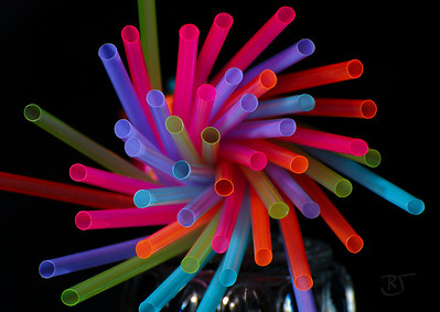 Day 175.1 - Neon Straw Flower  Wanted to try these neon color straws we had.  I tried different lighting and came up with a few interesting patterns.   I've added a second photo using an uplight to create a pastel metallic look. http://banjon.smugmug.com/gallery/4356946_mQ7BB#349597036_CDj3S  Added note:  These straws are translucent and only turn solid color when the flash was applied.  That was an added surprise. :)    Aug 10 2008