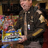 Right up his alley: Vigo County Sheriff's Department Deputy Chief Greg Ewing finds a toy to his liking as he helps unpack over 100 toys Thursday at the 14th and Chestnut Community Center. The toys were collected by members of the Sheriff's Department for children at the center.