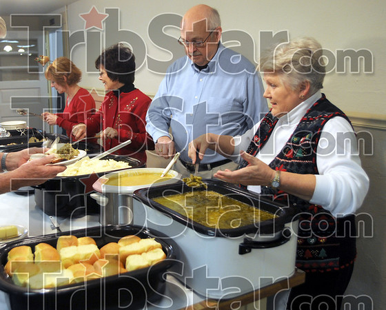 Servers: Marshall First United Methodist Church members (from left), Pattie Lashbrook, Kelly Lindley, Gordon Clark and Carolyn Clark serve during the Community Christmas Dinner Thursday.