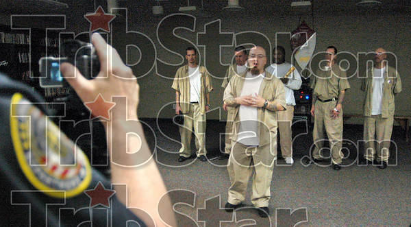 "Shakespeare: Wabash Valley Correctional Facility inmate Larry Newton (center) and other inmates perform before the video camera as they create an original adaptation of Shakespeare's ""Romeo and Juliette"" Thursday afternoon."
