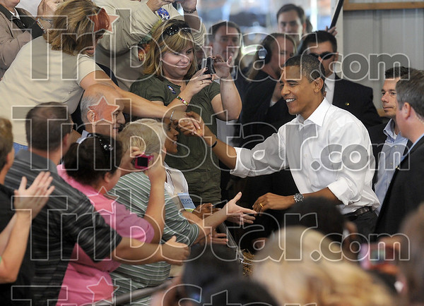 Welcome to Terre Haute: Democratic presidential candidate Barack Obama shakes hands with members of the audience upon his arrival in the 4H arena at the Wabash Valley Fairgrounds Saturday.