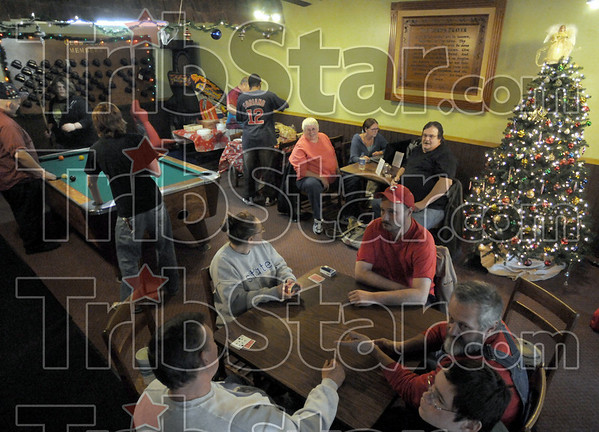 Holiday: Patrons of Club Soda gather to eat, play pool, play cards and sulrf the internet Sunday afternoon.