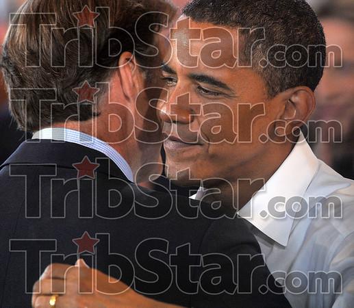 Hoosier hug: Ticket holders: Democratic presidential candidate Barack Obama receives a hug from Sen. Evan Bayh before Obama's presentation Saturday at the Wabash Valley Fairgrounds.