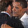 Hoosier hug: Ticket holders: Democratic presidential candidate Barack Obama receives a hug from Sen. Evan Bayh before Obama's presentation Saturday at the Wabash Valley Fairgrounds.