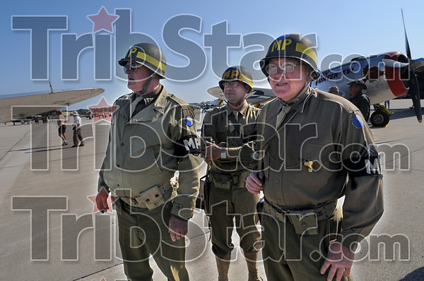Authentic: Mick Moore, Eric Jones and Mike Kapitan provide security in their MP uniforms during Sunday's Victory Day event.
