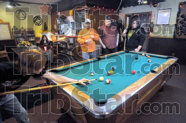 Club pool: Several patrons gather to play pool at Club Soday Sunday afternoon.