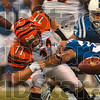 Coughed up: Cincinnati quarterback Ryan Fitzpatrick loses posession of the ball as he is tackled by an Indianapolis defender Sunday during the Colts' 35-3 win in Indianapolis.