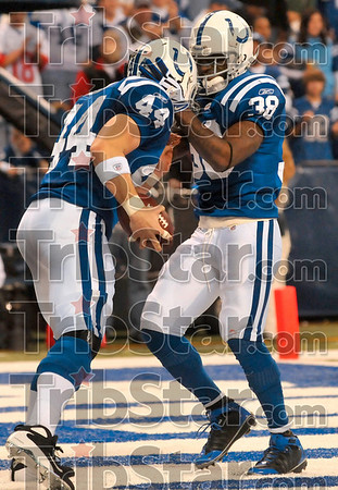 Happy ending in the endzone: Indianapolis tight end Dallas Clark is congratulated by teammate Joseph Addai after Clark scored against the Cincinnati defense Sunday in Indianapolis.