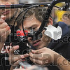Hands on: Triangle Fraternity member Nick Mohr of Louisville, Ky., assembles the brakes to a bike as the handlebars are held steady by fellow member Karl Frisk Saturday at Rose-Hulman.
