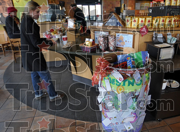 Gift barrel: A barrel containing gifts sits in the Starbucks coffee shop at 25th and Wabash containing gifts for kids at the 14th Street Community Center.