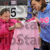 Just the right color: Nine-year-old Crystal Crandell receives some shopping help from Terre Haute South senior and Junior Department Club member Katelyn Gosnell, 18, during the I74th Annual Noon OptimistÕs ÒClothe-A-ChildÓ program at the southside WalMart Saturday.