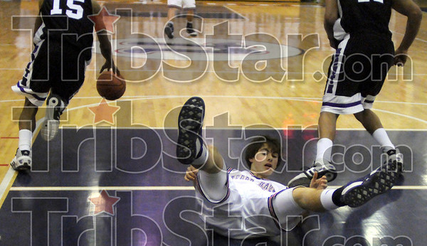 No-call: North's #12, Daniel Gabbard can't believe there was no call after being knocked to the floor and stripped of the ball during first quarter action against Bloomington South Saturday evening.