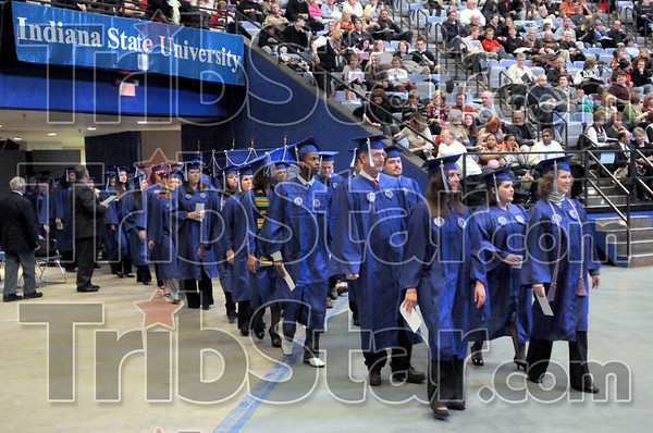 Processional: Indiana State University students enter Hulman Center during the processional Saturday afternoon.
