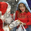 Is it really him?: Seven-year-old Ayonna Varvel is surprised as she is presented with a gift from Santa Claus during the 74th Annual Noon OptimistÕs ÒClothe-A-ChildÓ program at the southside WalMart Saturday.