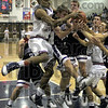 """Tangled: North's #32, Jerrel Thompson is called for an """"over the back"""" foul as he attempts to get an offensive rebound Saturday night against Bloomington South."""