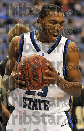 I can't believe I missed that!: Indiana State's Harry Marshall slaps the ball after he was fouled while shooting under the rim during the Sycamores' win over DePauw Saturday at Hulman Center.