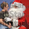 Listen closely, Santa: Ben Graham gives Santa Claus the lowdown on what he wants for the holiday during the West Vigo High School Ambassadors' Christmas Crusade Saturday at West Vigo Middle School.