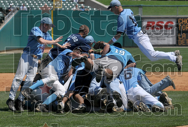 Champions pile: Members of the Shakamak baseball team pile on top of one another after they defeated Cowan to win the Class A state baseball championship Saturday, June 14 at Victory Field in Indianapolis.