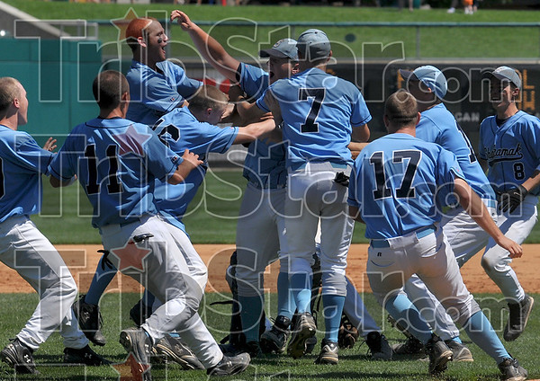 Beginning of a pile: Shakamak pitcher T.J. Hill, center, is mobbed by his teammates after the Lakers defeated Cowan to win the Class A baseball state championship Saturday, June 14 at Victory Field in Indianapolis.