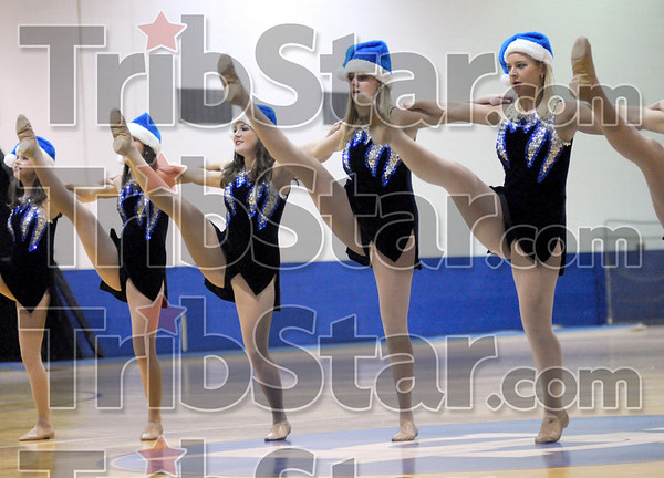 High steppers: Members of the ISU Sparkettes perform for a crowd of hundreds at the Arena Saturday morning.