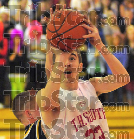 Eye on the prize: Jake Odum shoots from the paint late in the first half against Mooresville.