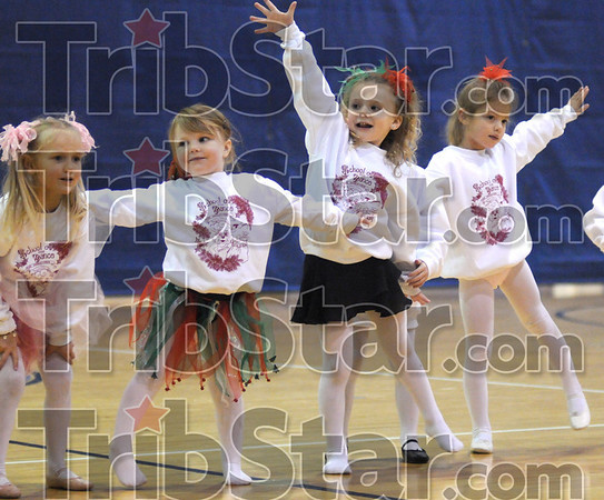 In-sync: Several young girls perform Saturday morning during a benefit for the 14th Street Community Center.
