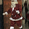 Here comes: Santa arrives at the arena Saturday morning as the ISU Sparkettes prepare to perform.