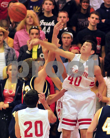 Not here: Terre Haute South center Adam Austin slaps away a shot by Mooresville's Matt Kenney early in their game Saturday night in the Braves' gym.