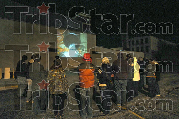 Theatre: Several ISU students watch a student produced video at the corner of 5th and Wabash Friday night.