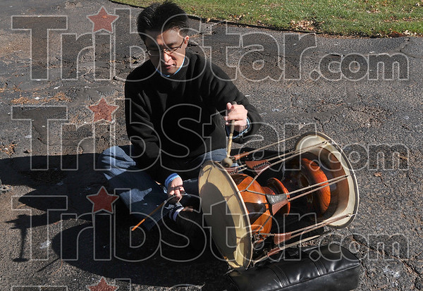 JangGu jam: Sung Choi demonstrates his JangGu, an hourglass-shaped drum, on the sidewalk outside Indiana State UniversityÕs Cunningham Memorial Library Friday, Nov. 21.