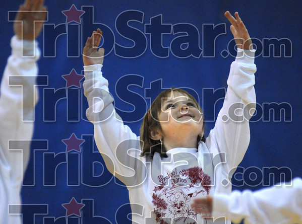 Angelic: A young dancer performs at the ISU south arena Saturday morning during a benefit performance for the 14th Street Community Center.