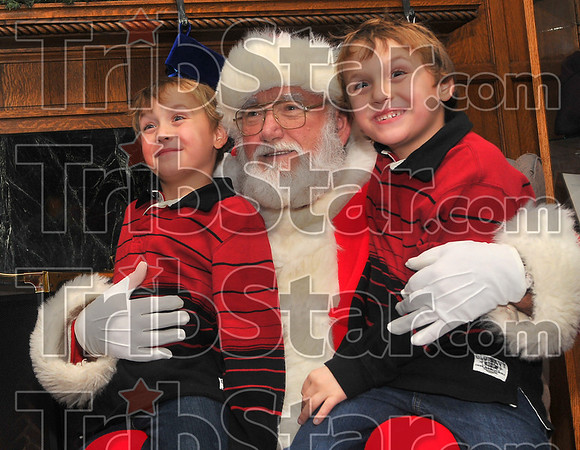 Oh yeah, we've been good: Will and Nick Cutter perch on Santas' lap before the play Mooseltoe at Tilson Auditorium Wednesday evening.