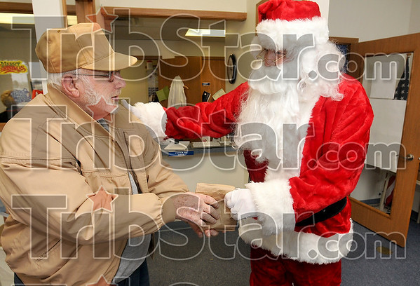 Something for the kid from New Goshen: Wayne Thomas receives a small gift from Santa Claus, a.k.a. Doug Ripberger, during Thomas' visit to the VA Outpatient Clinic Wednesday.