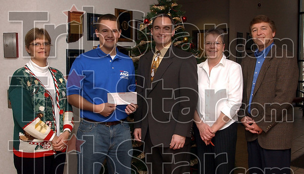 Funded: Rose-Hulman's Society of Civil Engineers once again provided a sizable donation tot eh Tribune-Star's Christ,mas Basket Fund. Pictured are Michelle Poorman, Jon Seger, a Rose-Hulman junior from Jasper, Tribune-Star publisher Jeremiah Turner, Sue Warnock and Tribune-Star editor Max Jones.