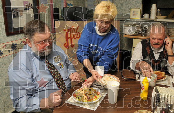 Great service for twenty years: George's Cafe waitress Kathy Selvia serves Indiana State aviation technology assistant professors Don Burger and Steve Shure at the beginning of the lunch hour Wednesday at the Cherry Street cafe.