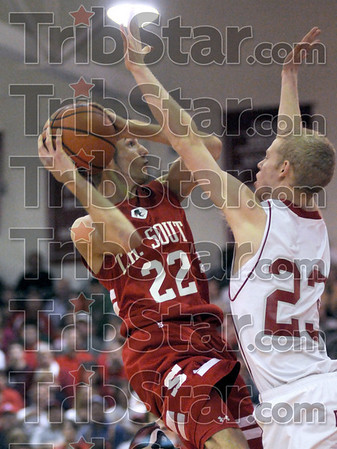 Defended: South's #22, John Michael Jarvis is blocked in his drive to the basket by Marshall's #23, Lucas Eitel.