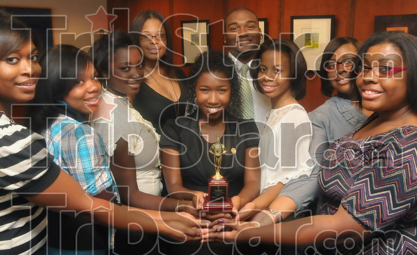 Team effort: Members of the Indiana State University NAACP Collegiate Chapter including Breanna Lee, Leona Woodson, Tanaviah Hinton, Brittany Crenshaw, Ebony Roberts, Jeremy Wolley, Sharon Sherron, Sade Edwards and Sasha Edwards display the chapter's NAACP 2nd Place Youth Chapter of the Year award Monday, Sept. 8 in the President's Office in Parsons Hall on the Indiana State University campus.