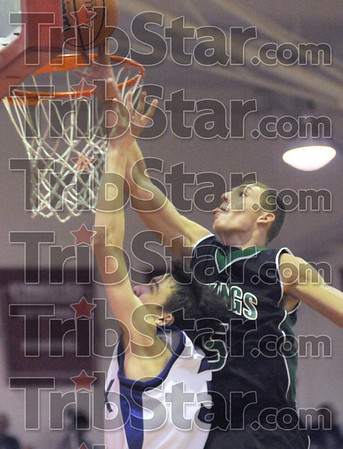 Goal-tending: West Vigo's #5, Tyler Wampler pins the ball against the backboard as he defends a Rockville layup Monday night during the semi-final game.