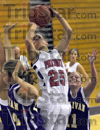 In traffic: North's #25, Danielle Ketner goes up for a shot in traffic against several Sullivan defenders Monday night.