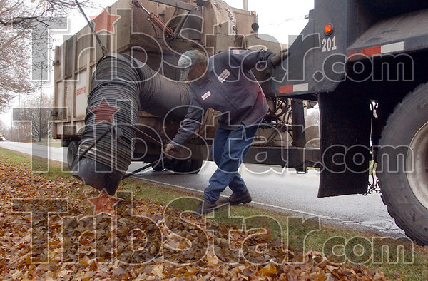 Leaf me alone: Jack Wittenmyer of the Terre Haute Street Department cleans leaves from the side of Margaret Avenue east of 25th street Tuesday afternoon. The crews are starting their second trip through the city, sucking  up what were award winning photos just a month ago.