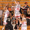 Stopped and blocked: Terre Haute South's Jake Odum blocks a shot by Arlington's Philip Freeman (23) as teammates Adam Austin and John Michael Jarvis move in Tuesday at South.