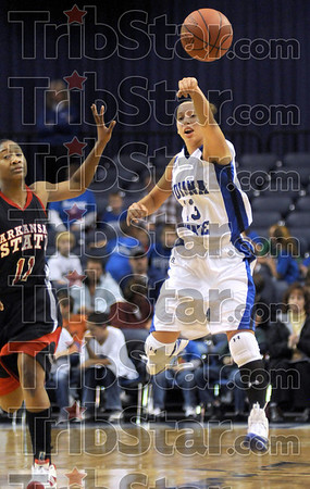 Push it: Indiana State's #13, Deja Mattox pushes the ball to an open teammate during Tuesday's game against Arkansas State. Chasing the play is #11, Ebonie Jefferson.