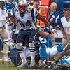 Pulled down: New England's Benjamin Watson is pulled down by Indianapolis' Clint Session in the first half during the Colts' game againt the Patriots Sunday in Indianapolis.