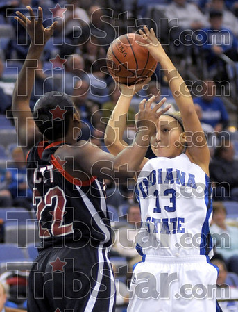 Jumper: Indiana State's #13, Deja Mattox takes a short jumpshot during first half action Tuesday night. Defending for Arkansas State is #22, Sherina Scott.