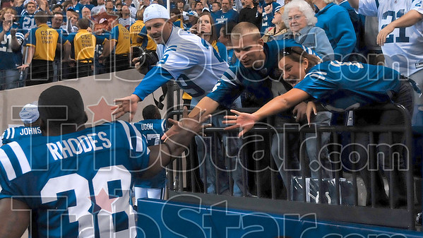 Right here, Dominic: Indianapolis fans reach out to congratulate running back Dominic Rhodes after the Colts' win over New England Sunday in Indianapolis.